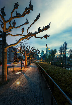 Vertical long exposure shot of the city of Frankfurt in the evening