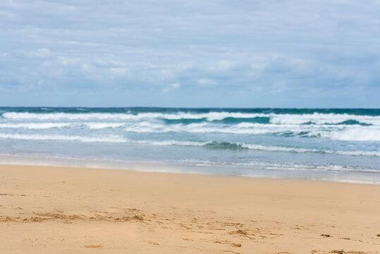 The coastal strip of the beach and ocean of the tropical island. Horizon line, sky, clouds.