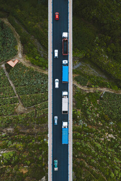 Aerial view of vehicles driving on the bridge over the ravine in La Palma island, Canary Islands, Spain.