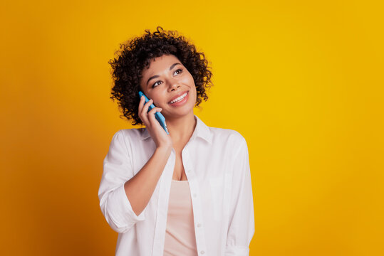 Close up portrait of cheerful african american woman hold telephone make call listen