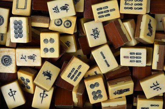 Vintage Bone and bamboo  Mahjong or mah-jongg playing tiles in box. Close up Background.