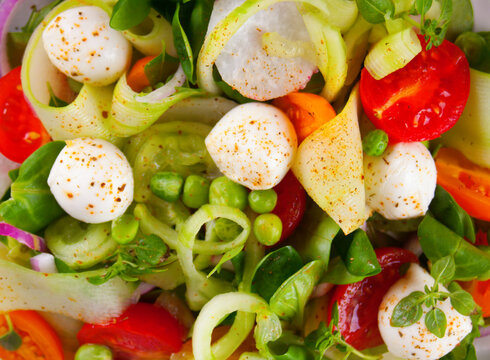 Fresh salad with vegetables and greens. Close up.