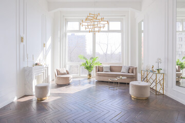 Obraz very light and bright interior of luxurious cozy living room with chic soft beige furniture with gold metallic elements, huge window to the floor and wooden parquet - fototapety do salonu