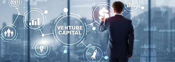 Fototapeta Venture capital. Investor capital. Businessman pressing virtual screen inscription
