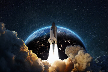 Fototapeta Rocket successful takeoff into deep starry space against the backdrop of the blue earth planet. Spaceship at launch from Earth, concept