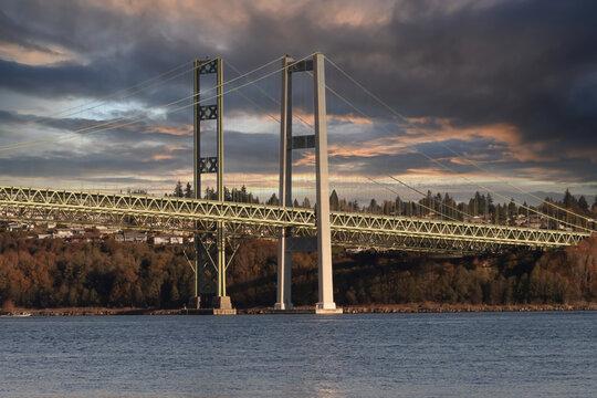 tacoma narrows bridge under dark storm clouds
