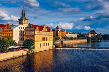 Prague in a sunny day, view of the old town, Prague, Czech Republic. Scenic summer view of the Old Town pier architecture and Charles Bridge over Vltava river in Prague, Czech Republic