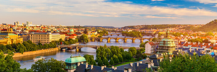 Fototapeta Scenic view of the Old Town pier architecture and Charles Bridge over Vltava river in Prague, Czech Republic. Prague iconic Charles Bridge (Karluv Most) and Old Town Bridge Tower at sunset, Czechia.