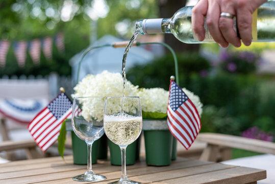 Enjoying a glass of wine in the backyard