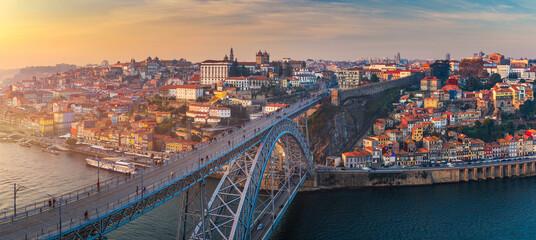 Fototapeta Porto panoramic aerial view of Dom Luis Bridge at sunset. Porto, Portugal. Cityscape of Porto downtown touristic Ribeira