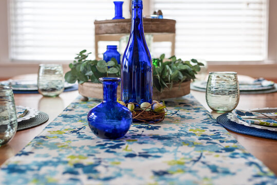 Closeup of spring table setting in blue and green palette