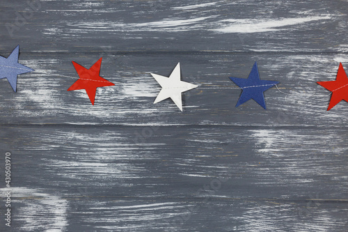 Decorations for 4th of July day of American independence, flag, candles, straws, paper fans. USA holiday decorations on a wooden background, top view, flat lay