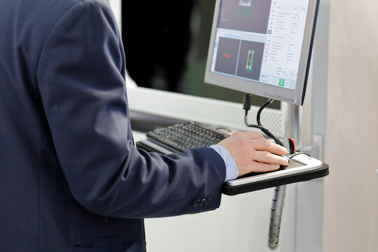 engineer controls the equipment using a computer