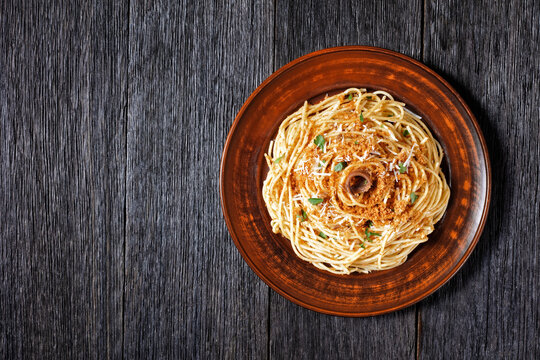 Pasta with anchovies, top view, copy space