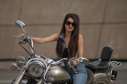 Portrait of young woman on a motorcycle