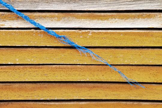 vintage orange wooden door with blue rope , background texture