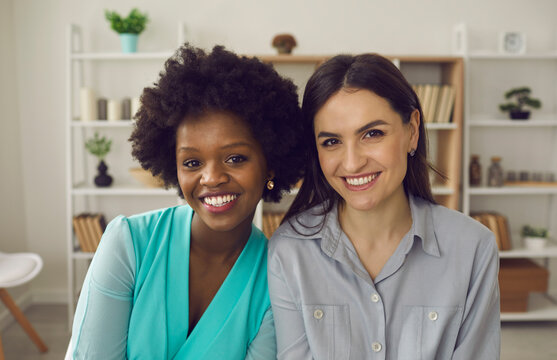 Friendly african american and caucasian coworker or students friends headshot portrait in office. Multiracial friendship, good quality racial diversity equality, equal opportunity in the workplace