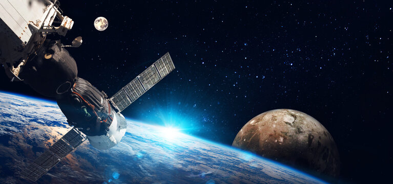 Space   station on orbit of the Earth planet and universe background. Elements of this image furnished by NASA