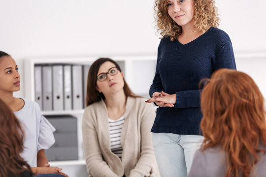 Group of women supporting each other at therapy session