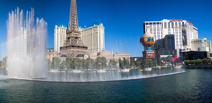 LAS VEGAS, NV, SEPTEMBER 13: Panorama of Bellagio fountains against a blue sky, Paris Las Vegas Resort, Eiffel Tower restaurant and Planet Hollywood Hotel in the background. USA 2012
