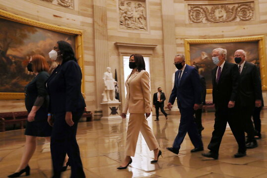 U.S. Vice President Kamala Harris leads a procession of senators ahead of the first address by U.S. President Joe Biden to a joint session of the U.S. Congress at the U.S. Capitol in Washington