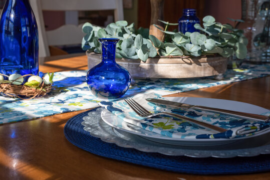 Pretty spring table setting with cobalt glass accents
