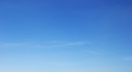 Blue sky background and white clouds soft focus, and copy space horizontal shape