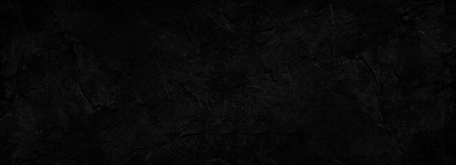 Black abstract background. Dark rock texture. Black stone background with copy space for design. Web banner.