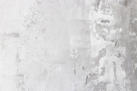 Gray concrete wall painted in white and gray, loft style. Texture