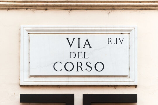 Via del Corso street sign on the main street of Rome, famous for shopping, Italy