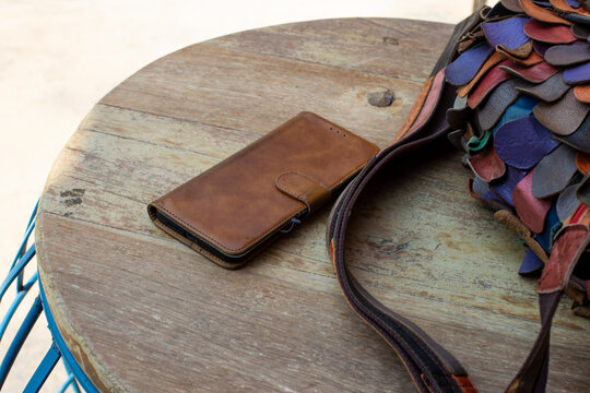 Bags and smartphones in a leather case