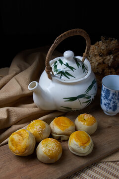Chinese snack with teapot and teacups