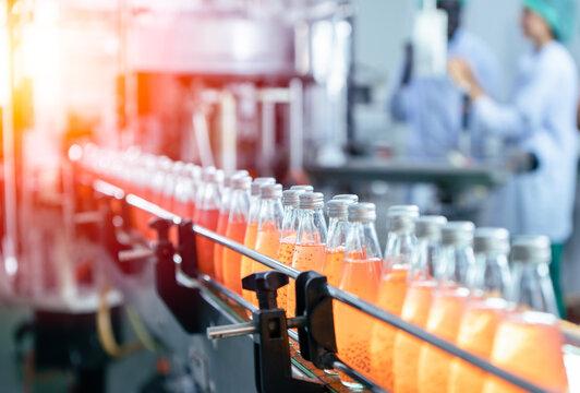 Drink factory production line fruit juice beverage product at conveyor belt.