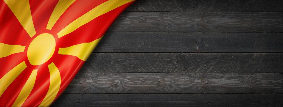 Macedonian flag on black wood wall banner