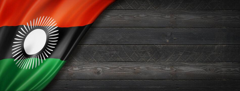 Malawi flag on black wood wall banner
