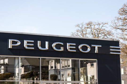 siegen, north rhine westphalia/germany - 25 04 2021: a peugeot car sign on a building