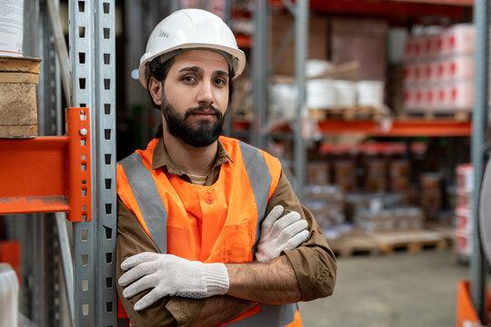Mixed race storeroom worker in helmet