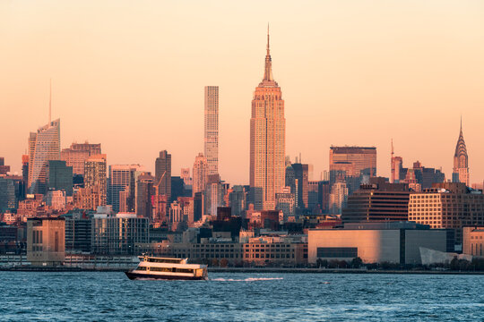 Manhattan skyline at sunset with Empire State Building, New York City, USA