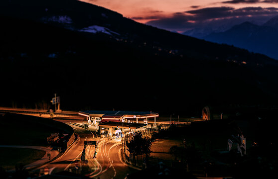 toll gate and sunset in the Alps.