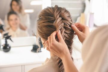 Fototapeta Hairdresser working with client in beauty salon obraz
