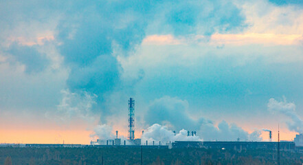 Fototapeta Smoke from pipes at the plant pollutes the environment