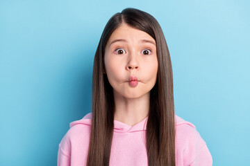 Photo of playful childish schoolgirl dressed pink outfit showing fish face isolated blue color background Wall mural
