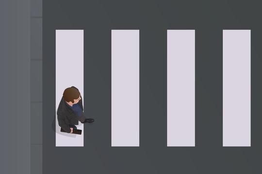 Concept et symbole d'un esprit discipliné, avec un homme vu du dessus, qui traverse la rue sur un passage piéton.