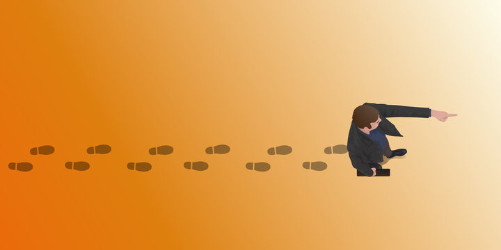 Concept du leadership et de la stratégie d'entreprise, avec un homme qui indique du doigt la direction à suivre.