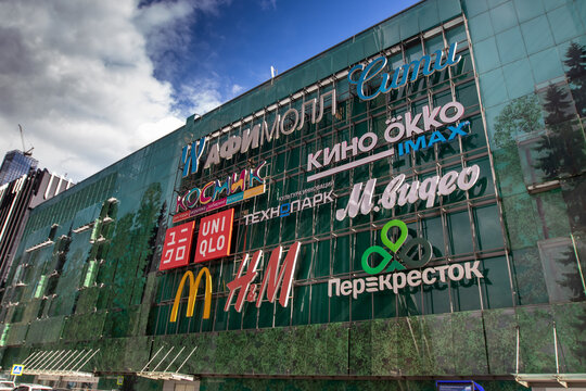 The store logos on the exterior wall of a shopping mall in Moscow, Russia.