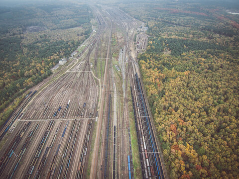 Autumn forest and railway depot aerial view