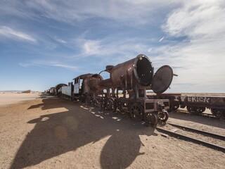 Old historic abandoned train engine locomotive ruins at Cementerio de Trenes cemetery graveyard, Salar de Uyuni Bolivia