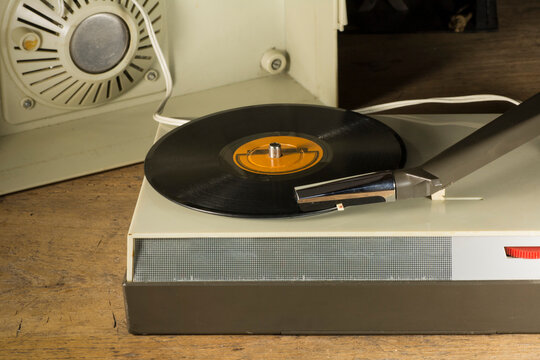 Old record player playing a vinyl