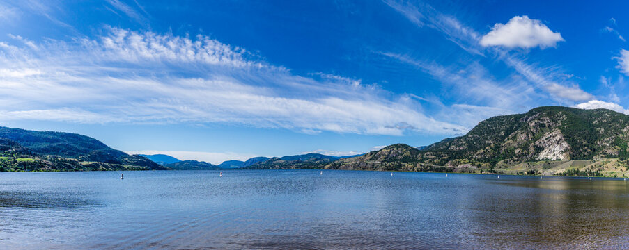 beautiful Skaha lake panorama with blue sky and white clouds summer morning
