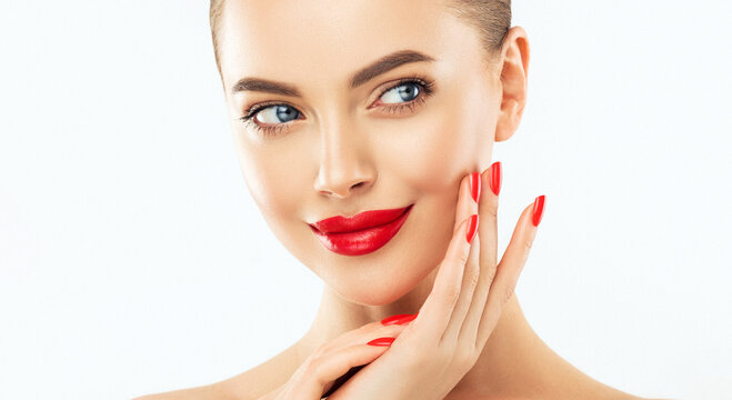 Beautiful woman showing red  manicure nails . Makeup, beauty and cosmetics. Famele beauty face care and treatment. Expressive facial expressions